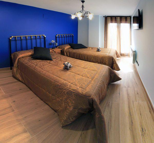 Apartamento Calleja: Habitación de dos camas.